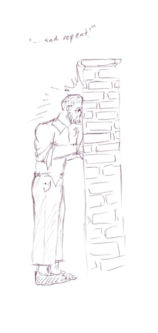 man banging his head against a wall