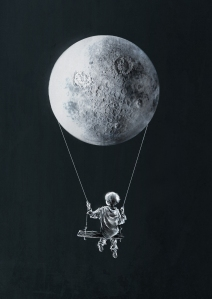 Boy swinging from moon