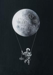 Boy swinging from moon